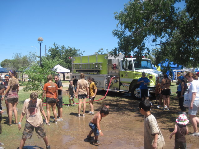 Cleaning off at Mighty Mud Mania via the local Fire Department