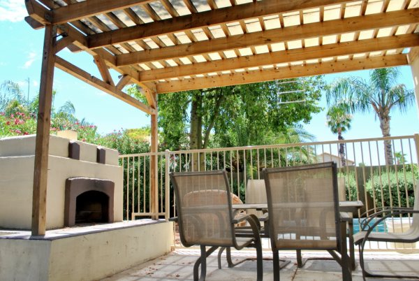 Backyard Entertaining area w/ fireplace & Pool